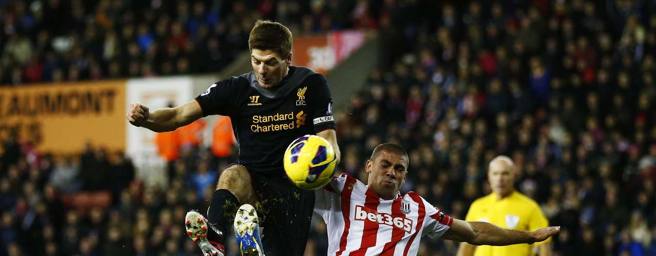 Liverpool's Steven Gerrard (L) challenges Stoke City's Jonathan Walters