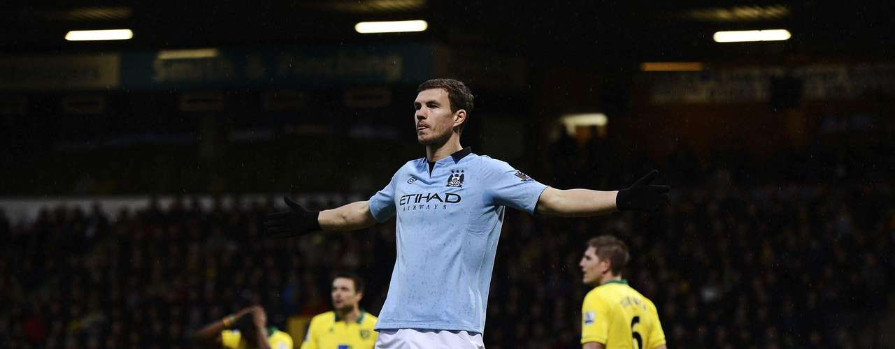 Dzeko celebrates after scoring his first goal.