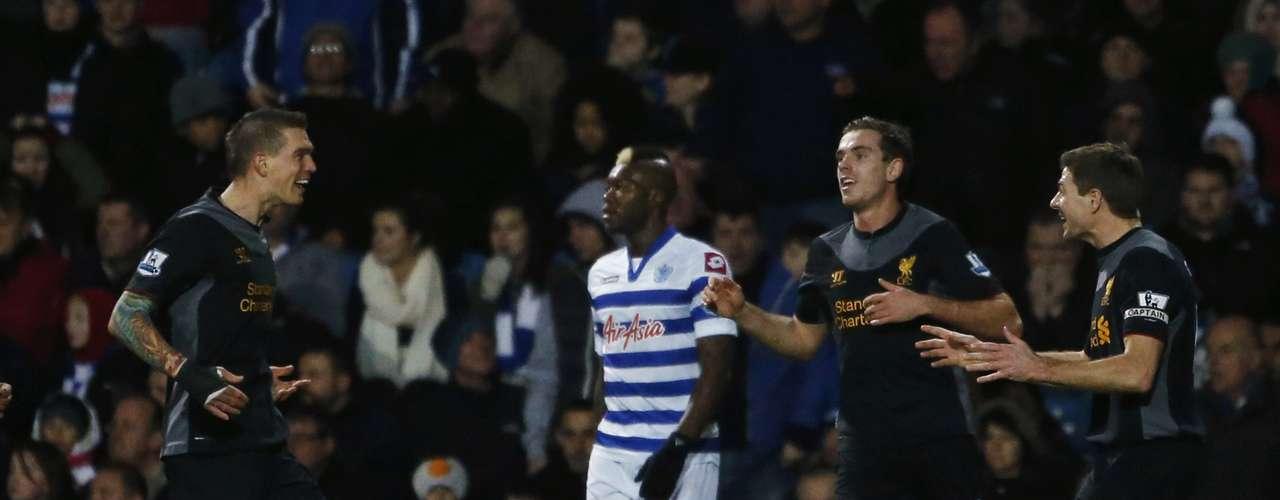 Liverpool's Daniel Agger (L) celebrates scoring a goal. REUTERS/Eddie Keogh