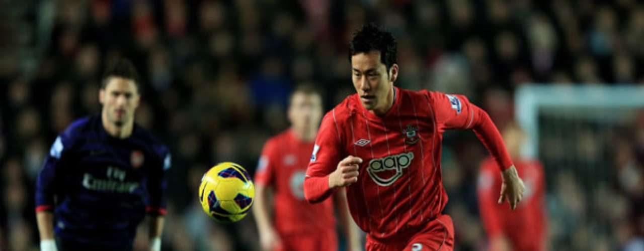 Maya Yoshida of Southampton vies for control of the ball.