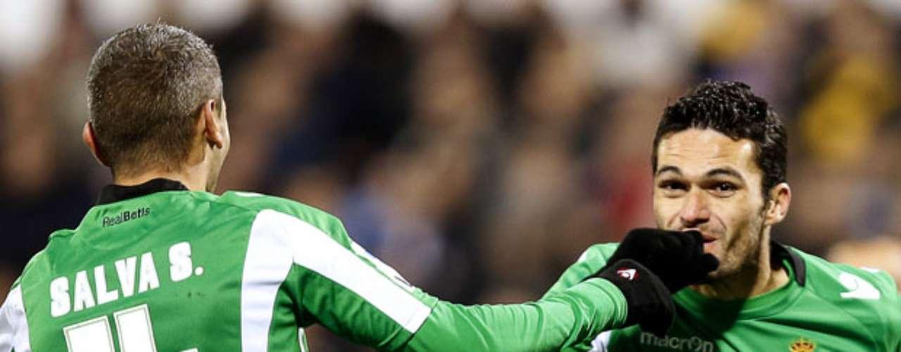 Betis' forward Jorge Molina (R) celebrates with Betis' midfielder Salva Sevilla after scoring.