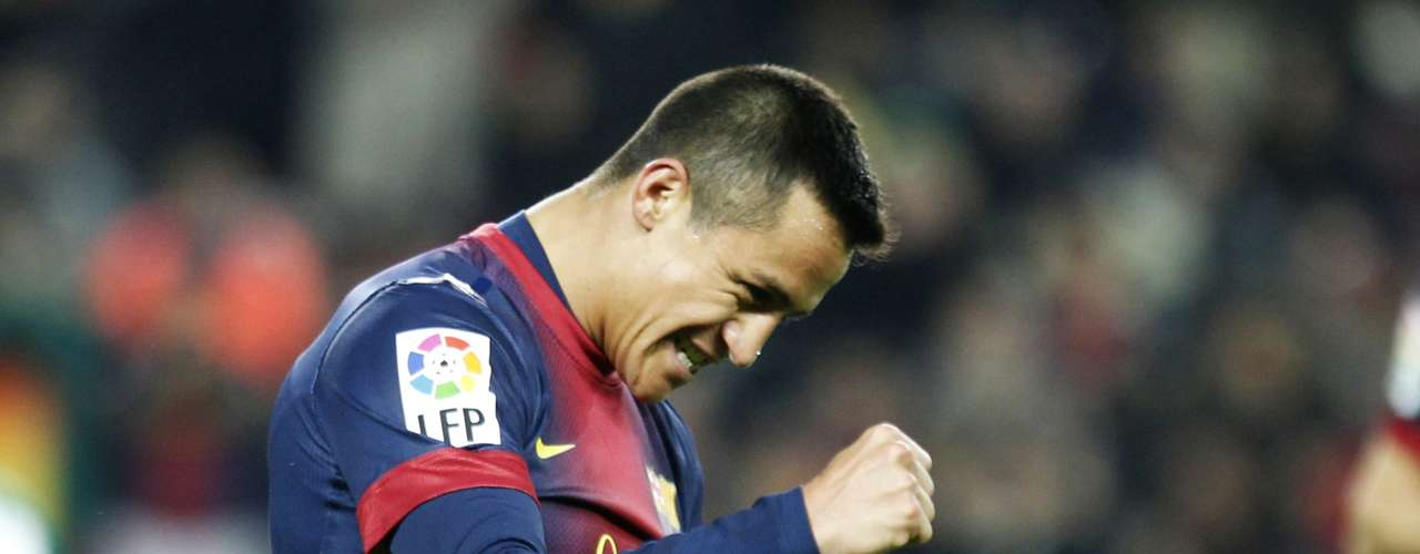 Alexis Sanchez celebrates his second goal against Cordoba.