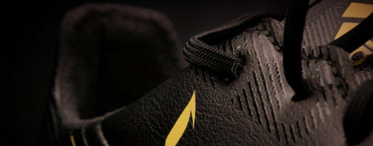 The shoes feature several design elements including Messi's logo, emblazoned in gold, as one might expect.