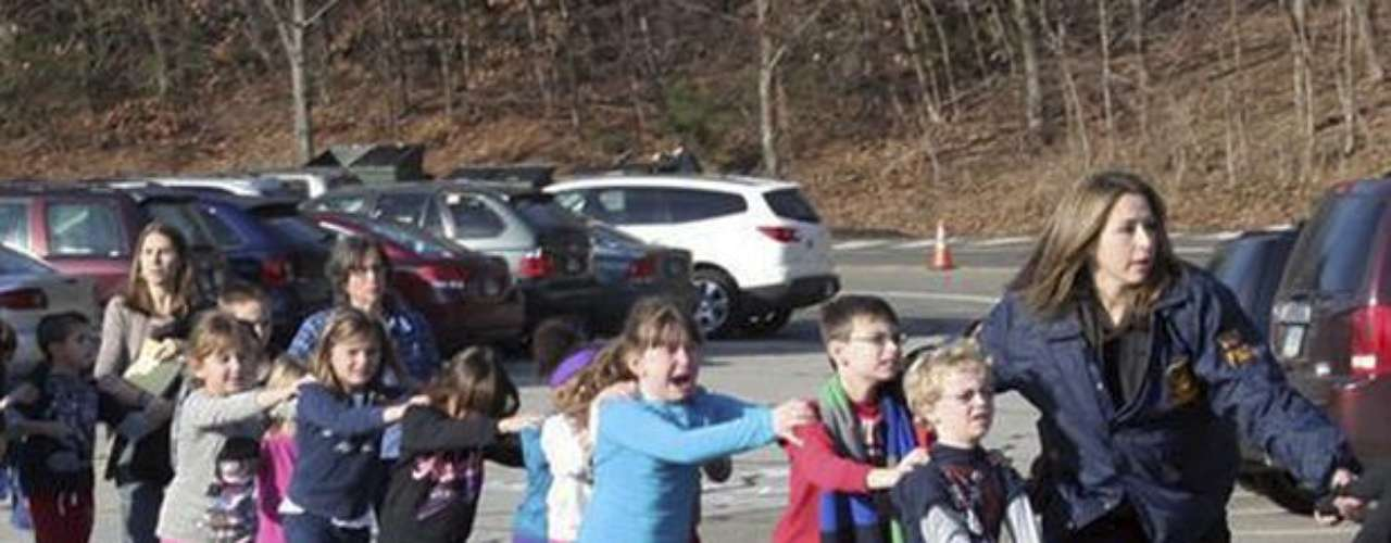 The shooter was 20-year old Adam Lanza. Police investigation found out that he killed his mother before leaving his house and then went to the school where he shot and killed 20 children and 6 adults, including the school's director, to finally commit suicide.