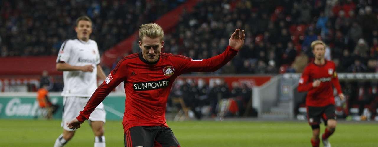 Bayer Leverkusen's Andre Schuerrle scores a goal. REUTERS/Ina Fassbender