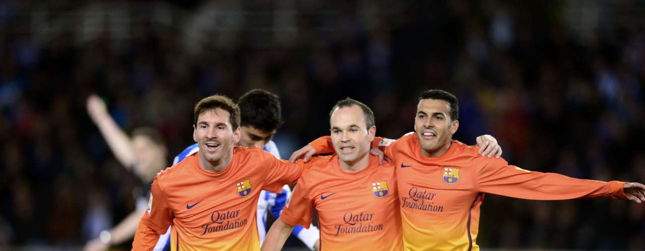 Barcelona's (L-R) Lionel Messi, Andres Iniesta and David Villa celebrate a goal by Messi.