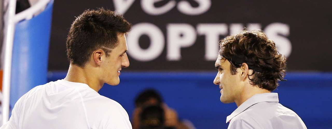 Federer shakes hands with Tomic. REUTERS/Daniel Munoz