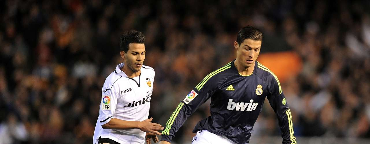 Ronaldo takes on a defender. As a result of the tie, Madrid qualified for the semi-finals of the Copa del Rey tournament.