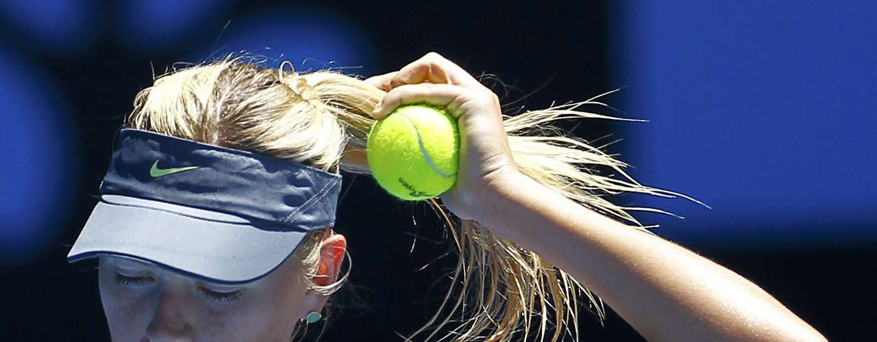 Sharapova adjusts her hair before serving to Li Na. It didn't help. REUTERS/Navesh Chitrakar