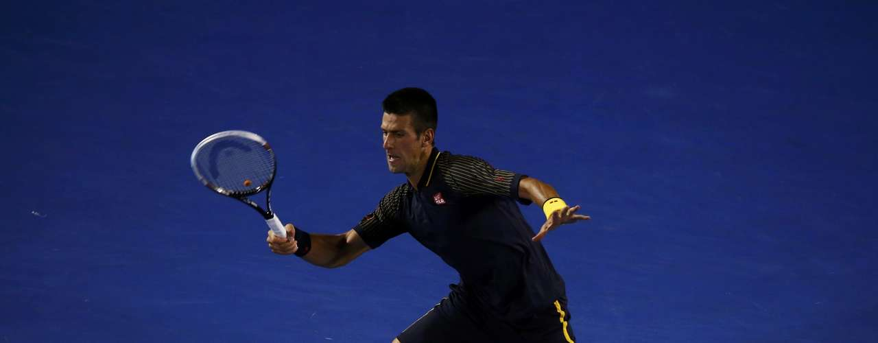 Novak Djokovic of Serbia hits a return to David Ferrer of Spain during their men's singles semi-final match.
