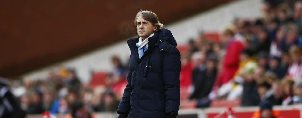 Manchester City's manager Roberto Mancini watches as his team plays Stoke City.