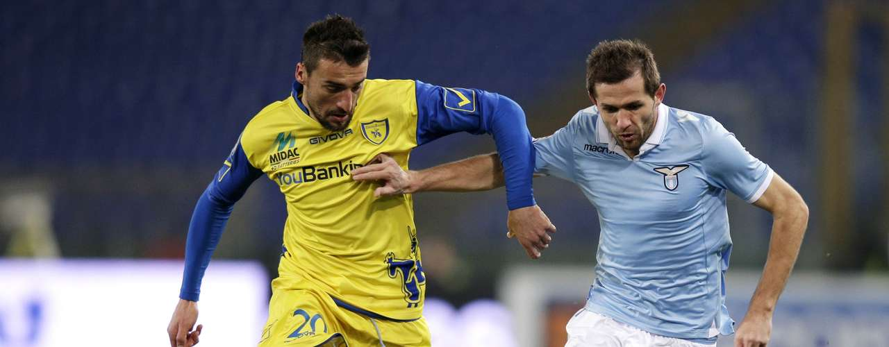 Lazio's Senad Lulic (R) challenges Chievo's Sardo. REUTERS/Max Rossi