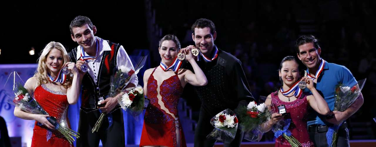 First placed Marissa Castelli and Simon Shnapir (C) are flanked by second placed Alexa Scimeca and Christopher Knierim (L) and third placed Felicia Zhang and Nathan Bartholomay on the podium after winning the Pairs competition at the U.S. Figure Skating Championships in Omaha, Nebraska, January 26, 2013.  REUTERS/Jim Young  (UNITED STATES - Tags: SPORT FIGURE SKATING)