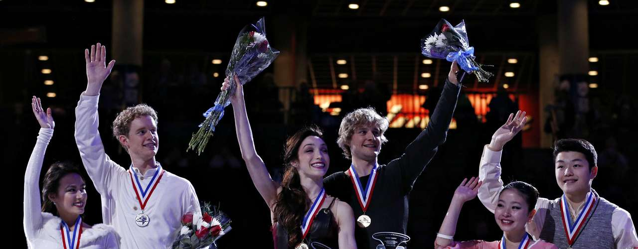 First place Meryl Davis and Charlie White (C) are flanked by second place Madison Chock and Evan Bates (L) and third place Maia and Alex Shibutani on the podium after winning the Dance competition at the U.S. Figure Skating Championships in Omaha, Nebraska, January 26, 2013.  REUTERS/Jim Young  (UNITED STATES - Tags: SPORT FIGURE SKATING)