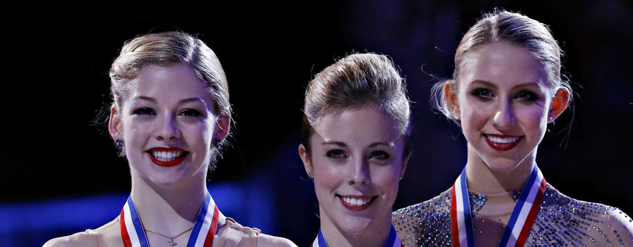 First place Ashley Wagner (C) is flanked by second place Gracie Gold (L) and third place Agnes Zawadzki in the Ladies competition at the U.S. Figure Skating Championships in Omaha, Nebraska, January 26, 2013.  REUTERS/Jim Young  (UNITED STATES - Tags: SPORT FIGURE SKATING)