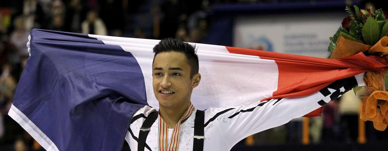 Silver medallist Florent Amodio of France holds his national flag during the award ceremony for the men's skating at the European Figure Skating Championships in Zagreb January 26, 2013.    REUTERS/Antonio Bronic (CROATIA  - Tags: SPORT FIGURE SKATING)