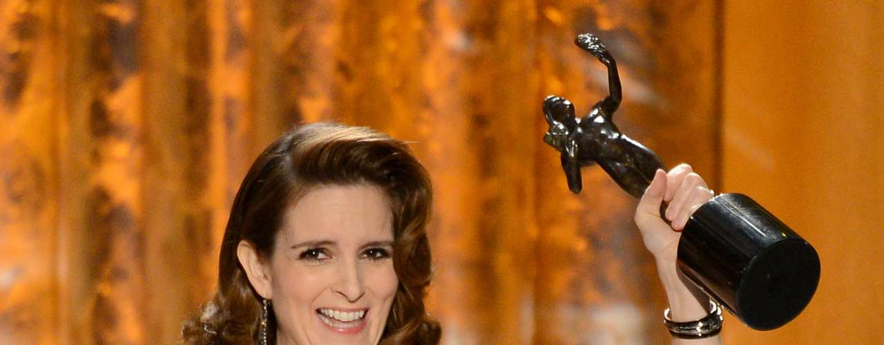 Tina Fey picks up her award for Outstanding Female Actor in a Comedy Series on '30 Rock' and thanks BFF Amy Poehler and jokes she's known her since before she 'gave birth to['Girls' creator] Lena Dunham'