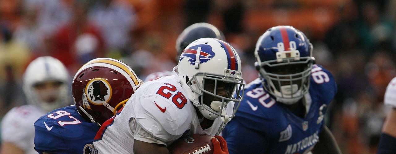 Buffalo Bills running back C.J. Spiller (28) of the AFC gets tackled by Washington Redskins special teamer Lorenzo Alexander (97) of the NFC as New York Giants defensive end Jason Pierre of the NFC looks on during the fourth quarter the NFL Pro Bowl at Aloha Stadium in Honolulu, Hawaii January 27, 2013. REUTERS/Hugh Gentry (UNITED STATES - Tags: SPORT FOOTBALL)