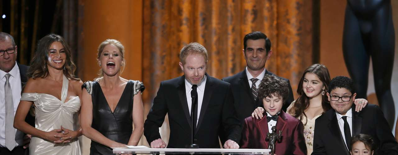 Jesse Tyler (C) Ferguson accepts the award for outstanding ensemble in a comedy series for \