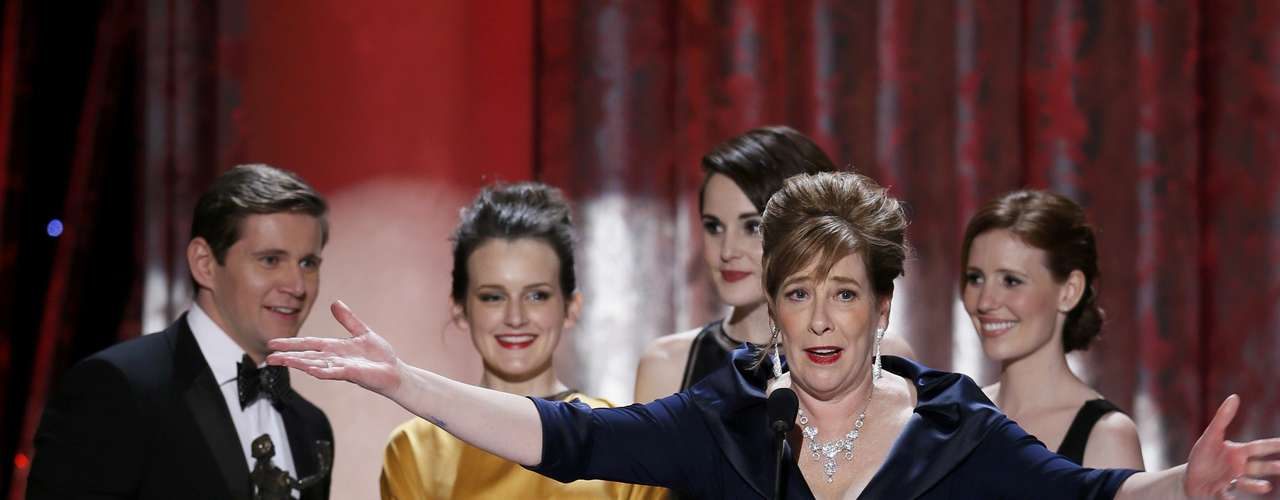 Actress Phyllis Logan (R, front) accepts the the award for outstanding ensemble in a drama series for \