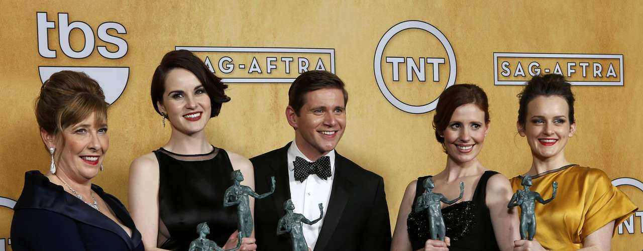 Cast members of the TV drama Downton Abbey hold their award for \