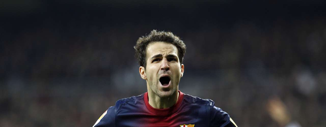 Fabregas scores Barcelona's only goal and celebrates.