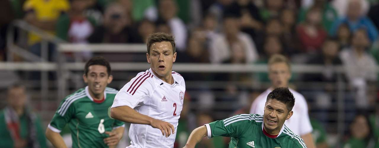 Mexico's Oribe Peralta battles with Denmark's Mads Alabek.