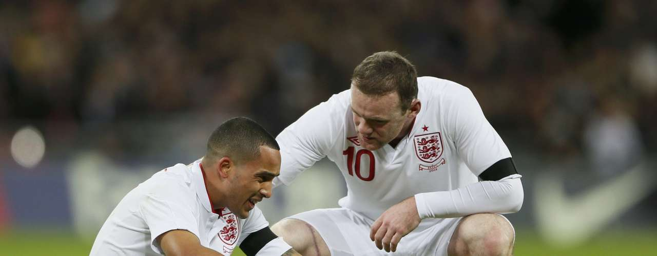 England's Wayne Rooney (R) checks on his team mate Theo Walcott during their international friendly soccer match.