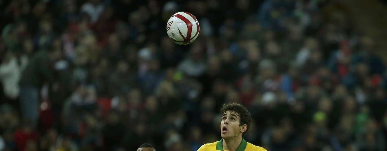 England's Ashley Cole challenges Brazil's Oscar (R) during their international friendly soccer match.