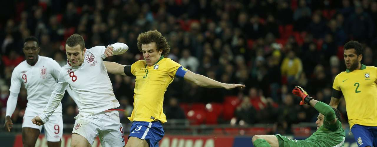 England's Jack Wilshere (2nd L) challenges Brazil's David Luiz (C) and goalkeeper Julio Cesar (2nd R).