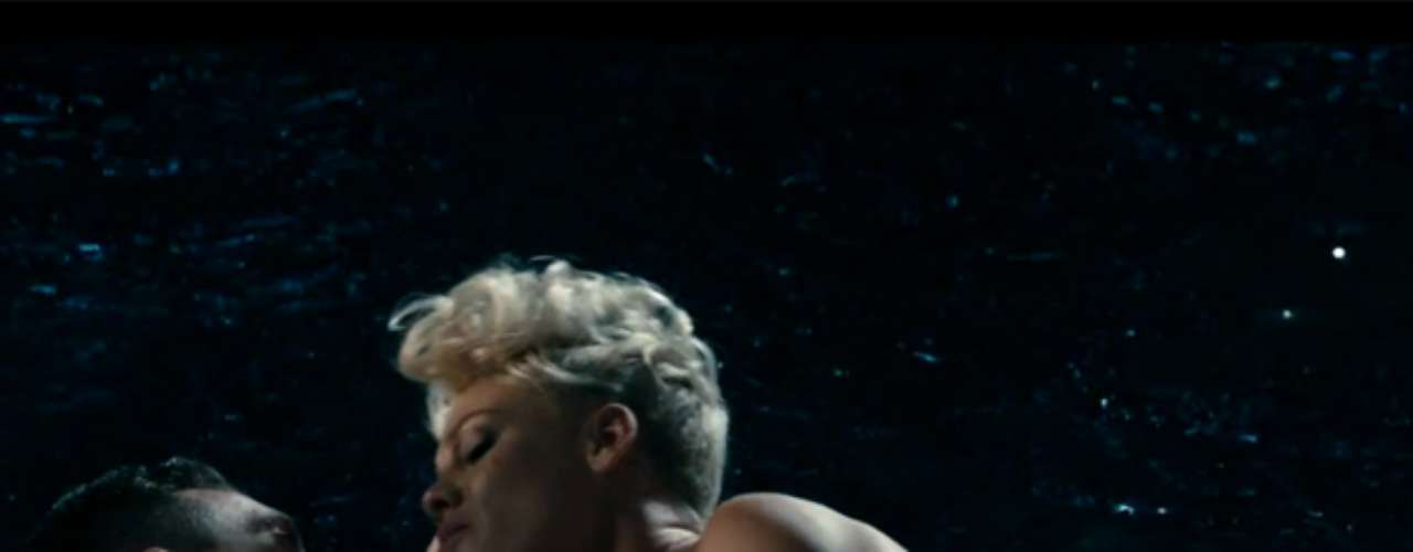 Pink gets hot and heavy with her husband Carey Hart in her new video, 'Just Give Me a Reason.'