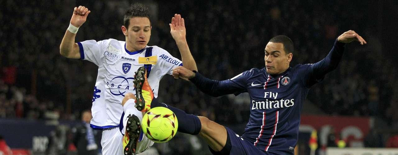 Bastia's Florian Thauvin (L) challenges Paris Saint-Germain's Gregory Van Der Wiel.
