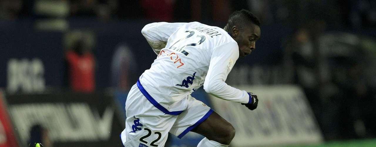 Paris Saint-Germain's Javier Pastore (L) tackles Bastia's Sambou Yatabare.