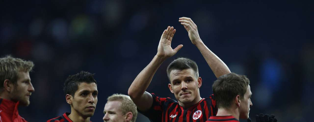 (L-R) Eintracht Frankfurt's Stefan Aigner, Karim Matmour, Sebastian Rode, Alexander Meier and Bastian Oczipka applaud the audience after winning tha match.