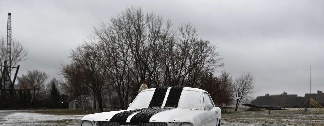 An automobile sits covered in a sleety snow mix as part of an art installation at Socrates Sculpture Park in the Queens borough of New York February 8, 2013. The northeastern United States braced on Friday morning for a blizzard that could drop up to three feet (nearly one meter) of snow through Saturday and bring travel to a halt.  REUTERS/Shannon Stapleton (UNITED STATES - Tags: ENVIRONMENT)