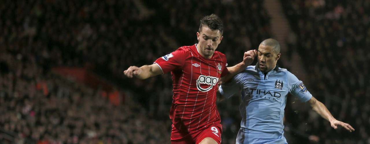 Southampton's Jay Rodriguez challenges Manchester City's Gael Clichy.