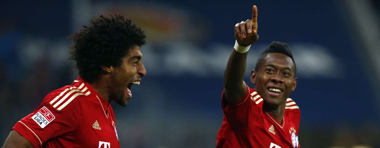 Bayern Munich's David Alaba celebrates with teammate Dante (L) after he scored.