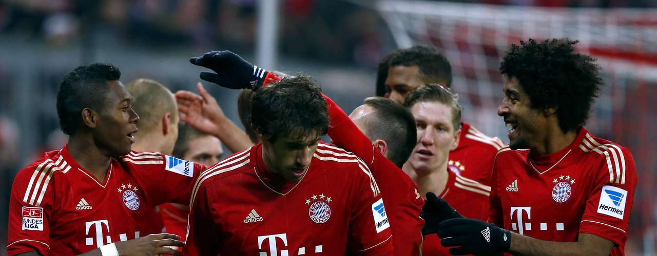 Bayern Munich players celebrate their third goal.