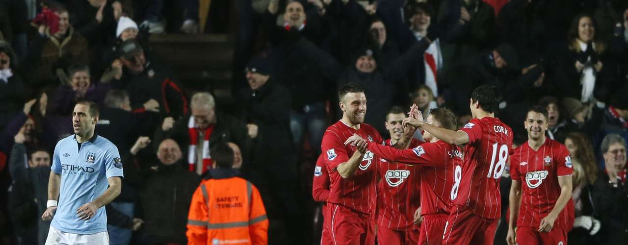Southampton players celebrate after Manchester City's Gareth Barry scored an own goal.