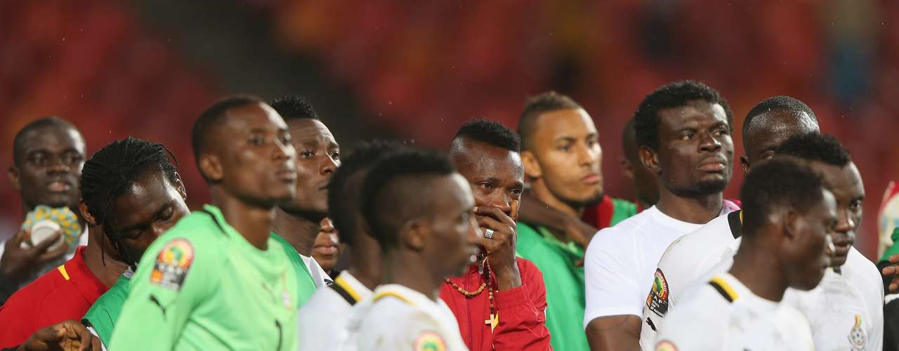 Ghana players are dejected after failing to medal during the African Cup.