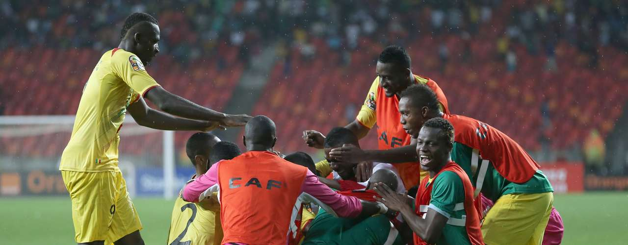 The Mali players rush the field after defeating Ghana 3-1 in the third-place match.