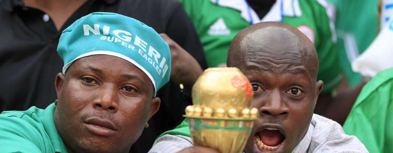 Nigerian soccer fans hold a replica trophy ahead of the African Nations Cup