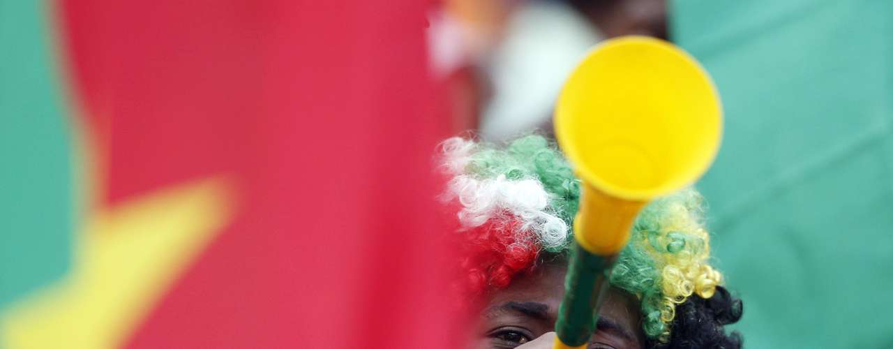 A Burkina Faso soccer fan blows a vuvuzela.