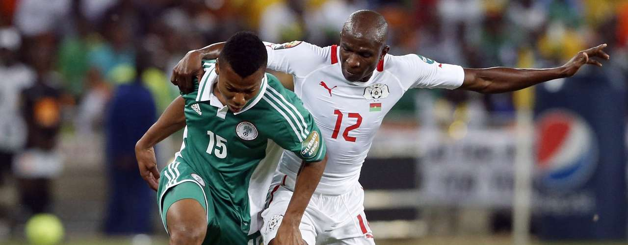 Burkina Faso's Saidou Panandetiguiri challenges Nigeria's Ikechukwu Uche (L) during the African Nations Cup.