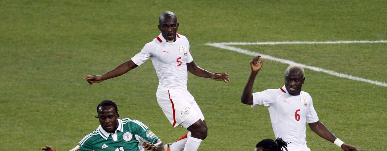 Burkina Faso's Bakary Kone (2nd R) challenges Nigeria's Victor Moses (L) as teammates Mohamed Koffi (5) and Djakaridja Kone look.