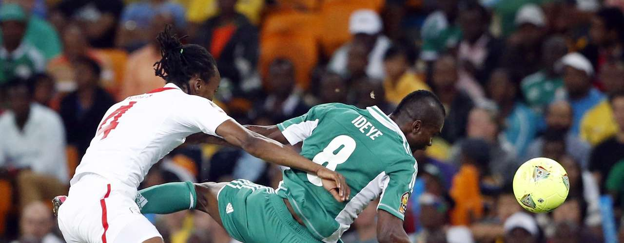 Burkina Faso's Bakary Kone (L) challenges Nigeria's Brown Ideye during the African Nations Cup final.