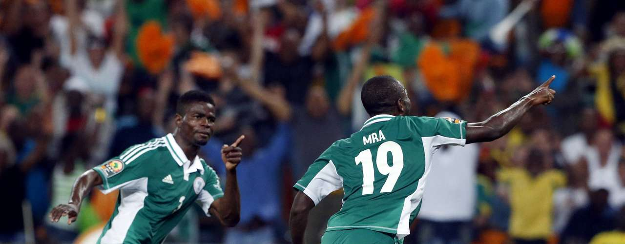 Nigeria's Sunday Mba (R) celebrates scoring against Burkina Faso during their African Nations Cup.