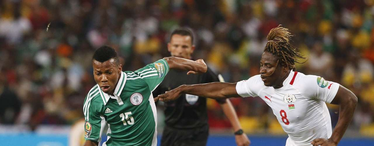 Burkina Faso's Paul Koulibaly challenges Nigeria's Ikechukwu Uche (L) during the African Nations Cup (AFCON 2013) final.
