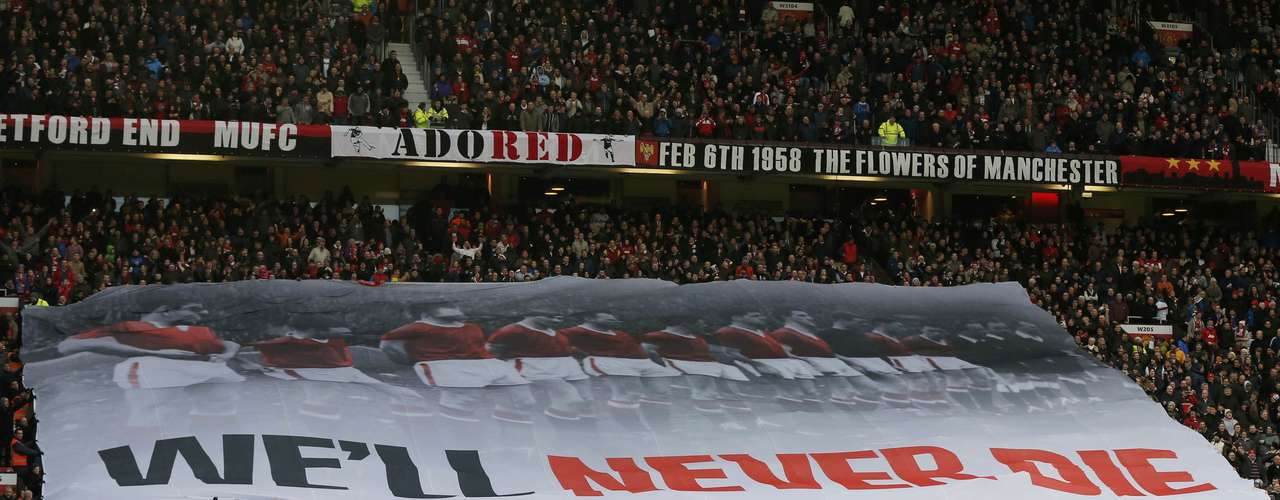 A banner is unfurled to commemorate the air crash in Munich 55 years ago which killed a number of Manchester United players and accompanying journalists.