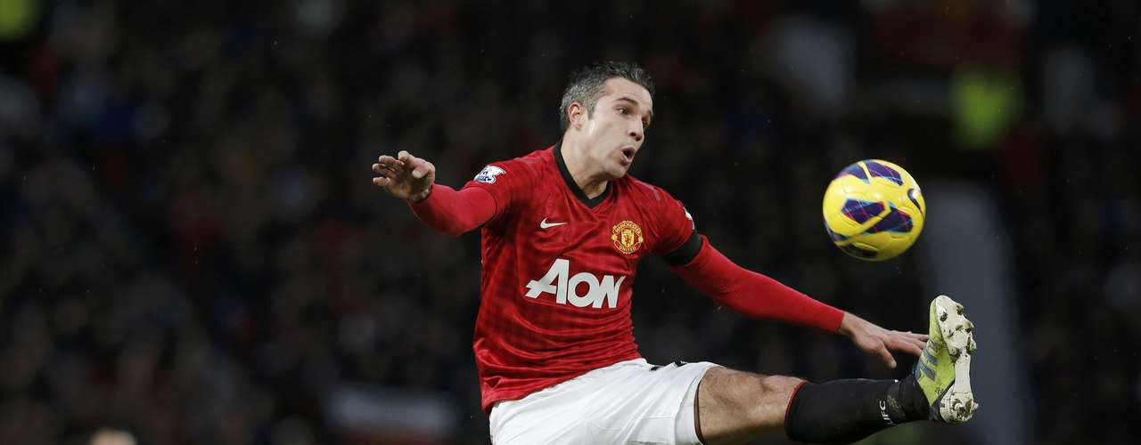 Manchester United's Robin van Persie jumps to control the ball.